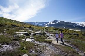 Two kids walking the Kärkevagge trail, Swedish Lapland. Mount Vassitjåkka in the background.