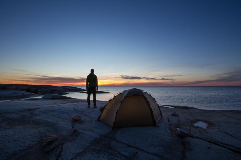 Tent in sunset at Håkanskär, Stockholm archipelago.