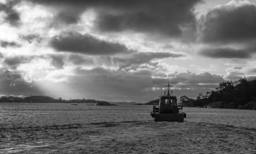 Silhouette of the pilot leaving Ankarudden heading for Landsort. Nynäshamn, Stockholm southern archipelago.
