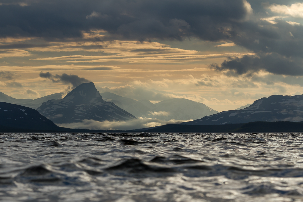 mountain-norway-sky-clouds-lake-waves-midnight sun