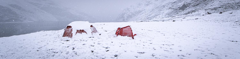 Översnöade tält i Rondane nationalpark